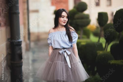 Young asians girl with modern dress posing in an old krakow stockfotos und lizenzfreie bilder - Foto moderne dressing ...