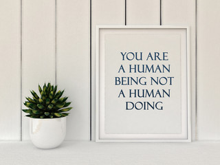 Inspiration motivation quote you are a human being not a human doing. Mindfulness , Life, Happiness concept. Poster in frame Scandinavian style home interior decoration. 3D render