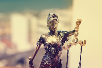 Sculpture of justice, femida or themis goddess on light copy space background