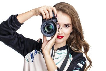 Young cheerful woman taking a picture over white background