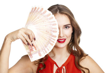 Russian rubles. Young happy woman holding a fan of money