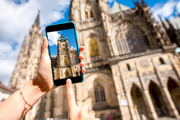 Photographing with phone famous Vitus cathedral in Prague city