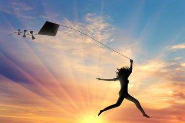 Girl runs sunset with kite