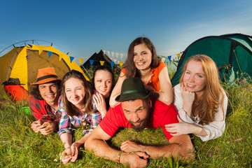 Funny young people enjoying with camping trip