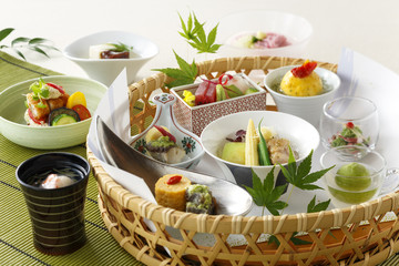 Basket of japanese food with sushi and vegetables soup