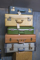 Vintage Suitcases I 1950s-60s / Vintage used suitcases stacked for sale.