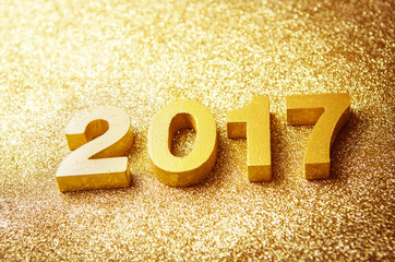 Fototapete - Closeup gold wood 2017 on glitter background, New year concept.