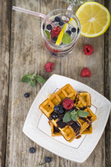 Delicious waffle with berries and chocolate