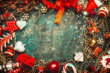 Christmas background with various red and white holiday decoration, top view, frame
