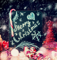 Merry Christmas lettering , red holiday decoration and snow. Festive greeting card