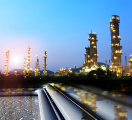 pipelines , towers,  oil and gas refineryTubes running in the direction of Pipeline transportation is most common way of transporting goods such as Oil, natural gas or water on long distances.