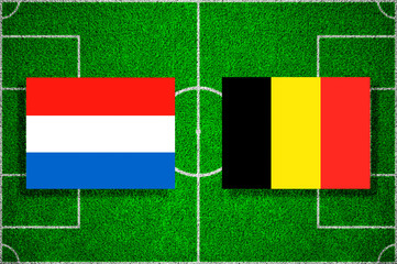 Flag Netherlands - Belgium on the football field. soccer friendly match