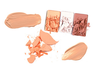 collection of various make up powder samples on white background