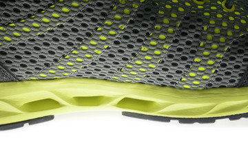 Close up men's sports shoe on a white background