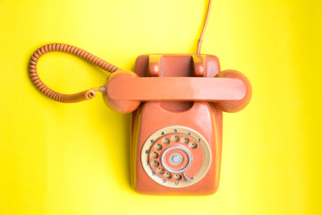flat lay Vintage telephone on pastel color background