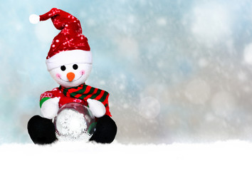 snowman in santa hat on a snowy background