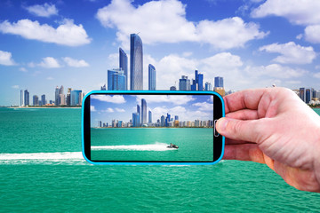 Making photos by smartphone in Abu Dhabi, UAE