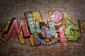 Colorful word MUSIC on brick wall background. Graffiti style