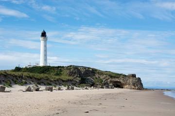 Coastal scene with beach and lighthouse