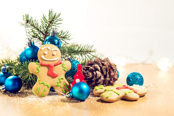 gingerbread man near Christmas tree with toys
