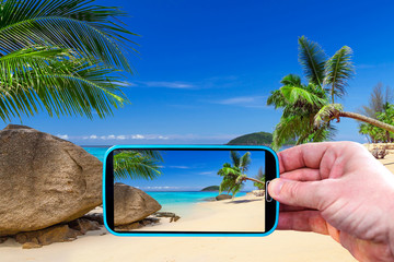 Making photos by smartphone of amazing beach