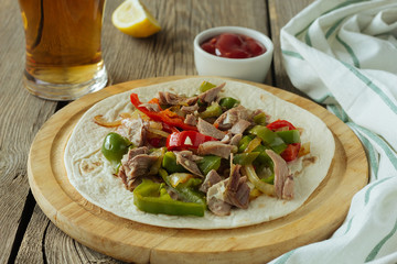 Tortilla with meat and sweet pepper