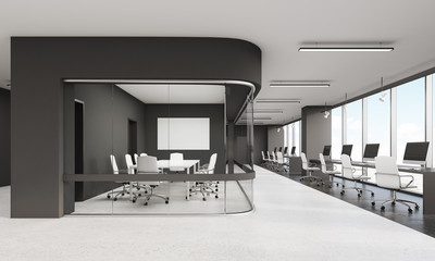Meeting room with glass wall and row of desktops