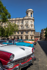 Cuban colorful vintage cars in front of National Museum of Fine Arts - Havana, Cuba