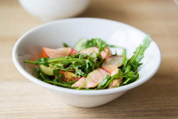 Hot meat salad with fresh radish in white plate