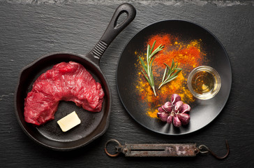 Wall Mural - Fresh rib eye steak and spices prepared for cooking