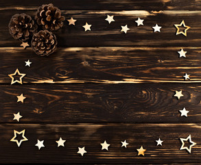 Wooden background with christmas wooden stars folded on the perimeter and 