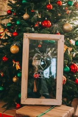 Christmas tree, gift boxes, wooden frame