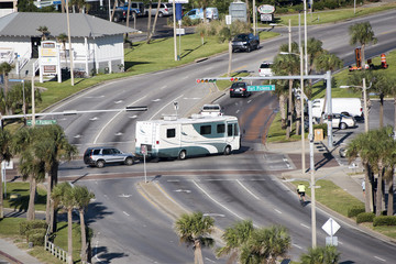 Pensacola Beach Florida USA - October 2016 - Overview of a RV towing a car over a road junction controlled by a traffic light