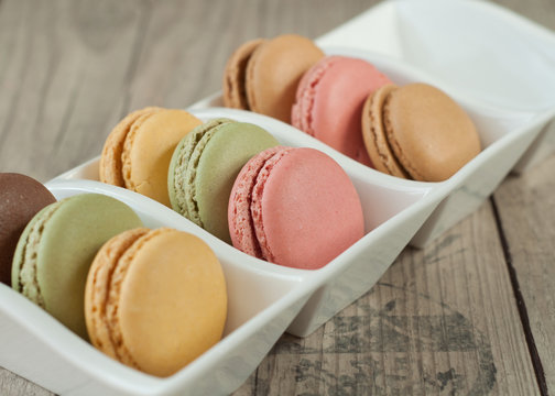 Colorful macaroons over turquoise wood backround