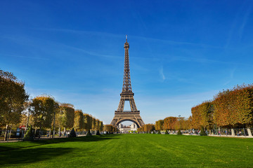 Scenic view of the Eiffel tower over blue sky