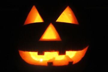 halloween pumpkin with lit candles