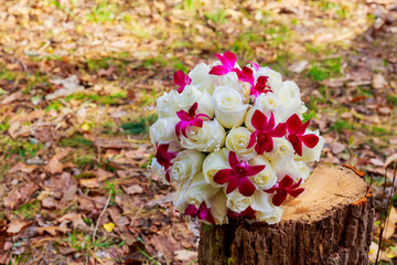 wedding bridal bouquet with white orchids, roses