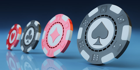 Gambling and casino concept, black and red poker chips with symbols of suits of playing cards and dices close-up view