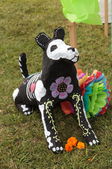 Flower and skeleton dog, cat and bird alter at Dia de los Muertos, Day of the dead, in Los Angeles at the Hollywood Forever Cemetery grounds.