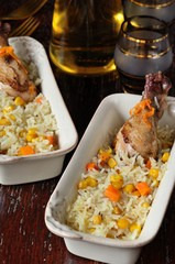 Garnish of boiled rice, corn, carrots and fried chicken legs