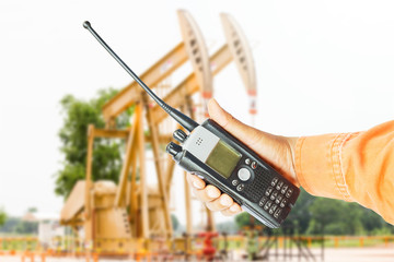 portable walkie-talkie radio in hand