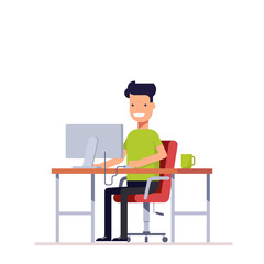 A young employee working at the computer. Programmer or freelancer working at the workplace. Happy young man uses the computer. Monitor and coffee on your table.