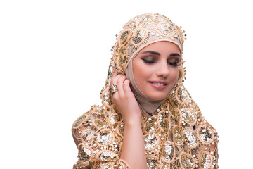 Muslim woman in gold cover isolated on white