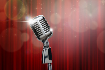 Retro microphone over the red curtain and bokeh background, vint