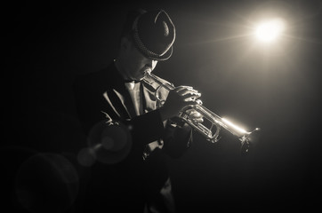 Musician playing the Trumpet with spot light on the stage Wall mural