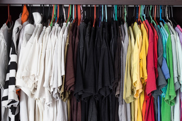 Colorful of T-Shirt hanging in wardobe