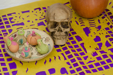 Traditional mexican candies and skull. Part of a mexican day of the dead offering altar