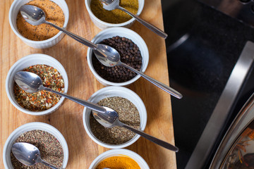various kinds of spices on black table