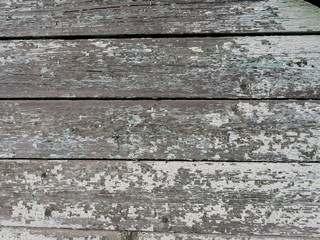 Old wooden background from the remains of paint and traces of use