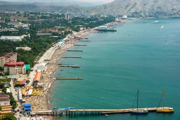 The beach of Sudak, between the Alchak mountain and Fortress mountain. Crimea. Sudak.